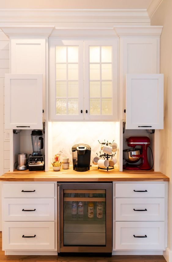 mini cabinets with sliding doors and with appliances hidden there plus a coffee station in the center is a stylish idea