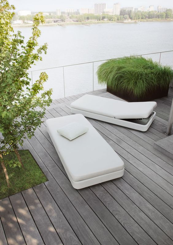 minimalist white loungers with a sleek design and backs that can be raised up for more comfort