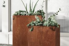 modern tall rusted metal planters will give a cool texture and color to the space and if you plant greenery, they will stand out