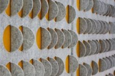 stylish grey and yellow acoustic wall panels make the space more modern and bold while soundproofing it