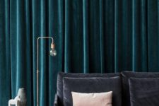thick velvet drapes will not only keep the sound but also cold away