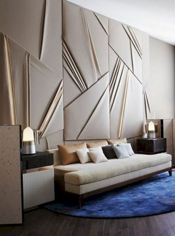 a draped fabric statement wall with lit up panels adds a chic geometric touch and a modern feel to the space