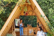 a secret garden shed shaped as a teepee, with a reading and painting nook is amazing