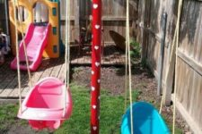 a simple colorful playground with swings, a colorful slide, a deck and a basketball space is awesome for active kids