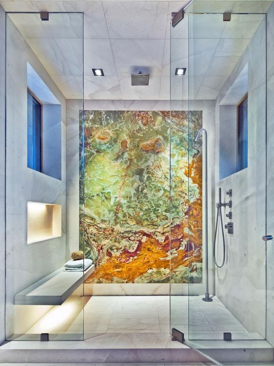 a spa-like shower space accented with a colorful geode statement wall that makes the shower even more gorgeous