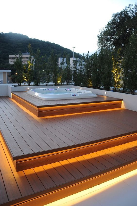 a step deck with each step illuminated and a sunken jacuzzi on top will let you enjoy relaxation, and greenery will hide you