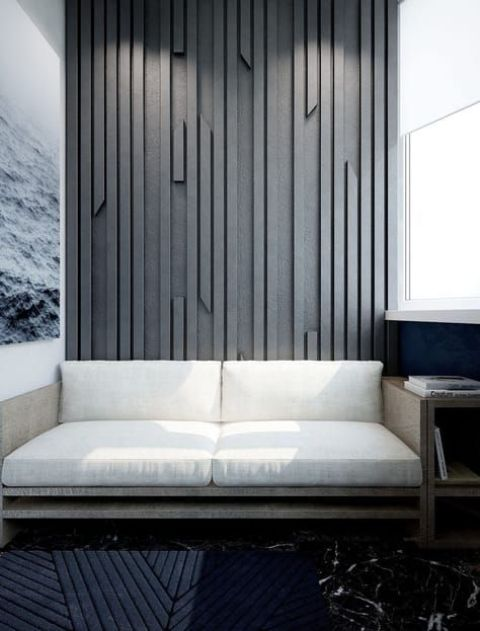 a textural accent wall done with wooden slabs attach to a plywood sheet and painted in an elegant grey shade