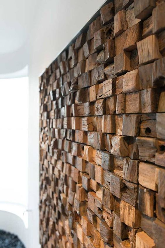 a textural weathered and driftwood piece wall creates a check pattern and adds a character to the room