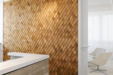 a unique textural accent wall clad with wooden shingles is a stylish contemporayr meets rustic idea