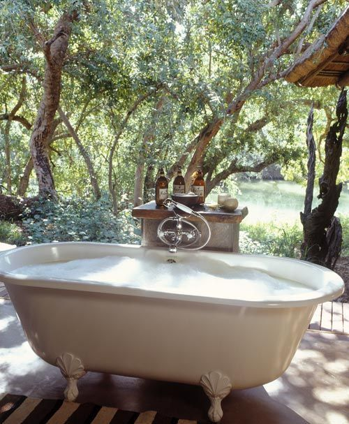 a vintage clawfoot bathtub with only the most necessary things is all you need to relax