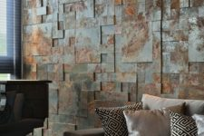 an aged metal accent wall brings industrial esthetics to the living room