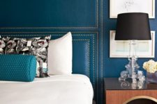 upholstering your wall with colored leather and decorating it with nails is a unique and luxurious solution