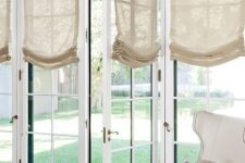 French windows styled with semi sheer neutral Roman shades look very chic, elegant and add coziness to the space
