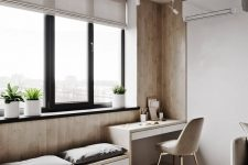 a contemporary neutral space with neutral semi-sheer Roman shades that block out the sun partly and match the room decor