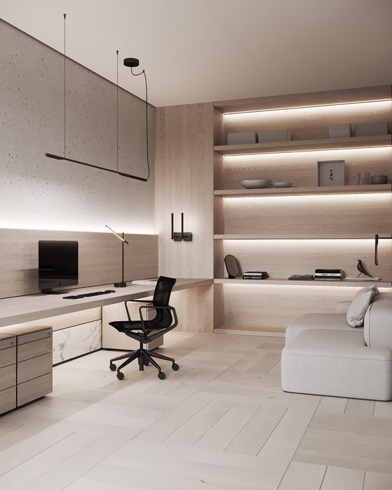 a luxurious minimalist home office with a sleek built in desk with storage, a black chair, a neutral sofa and built in shelves with lights is a cool space