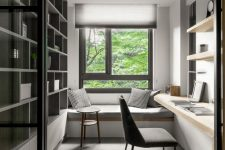 a minimalist home office with a built-in storage unit, a built-in desk and shelves, a windowsill daybed and pillows