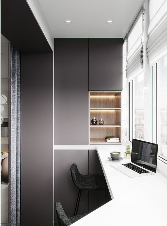 a minimalist home office with built-in storage units and shelves, a tall shared desk and a view is a very chic nook to work or have meals