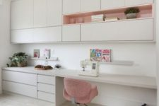 a minimalist white home office with sleek cabinetry, open storage units, a built-in desk with much storage and a basket for stuff