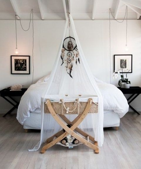 a mosquito net with a dreamcatcher accenting the baby crib is a cute idea to highlight this piece
