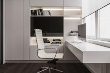 a refined minimalist home office with a large sleek built-in storage unit with built-in lights, a floating desk with storage, a chic white chair