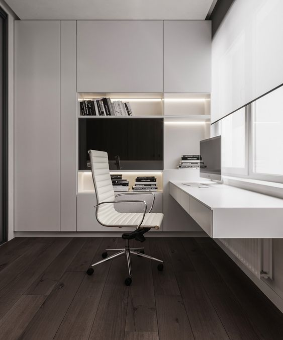 a refined minimalist home office with a large sleek built in storage unit with built in lights, a floating desk with storage, a chic white chair