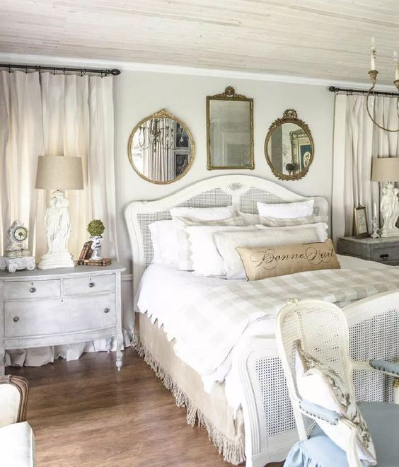 a shabby chic bedroom in neutrals, with refined furniture, touches of burlap, mirrors and pastel blue elements
