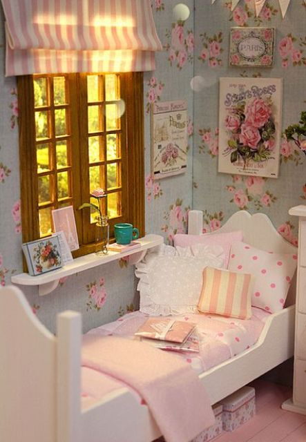 a shabby chic bedroom with floral walls, white furniture, pretty pink and striped bedding, a striped curtain and vintage posters