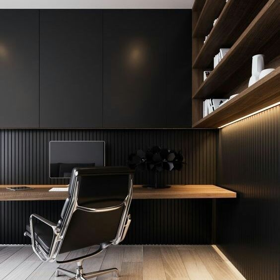 a stylish moody minimalist home office with a wood slab wall and a sleek storage unit, an open shelving unit and a floating desk plus a black chair