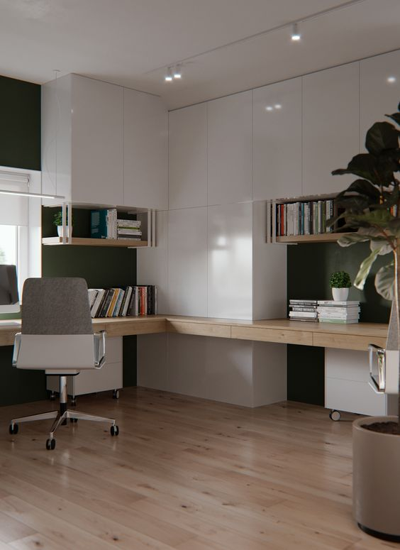 a very stylish minimalist home office with sleek white cabinets and a built in stained desk, a chair and potted plants