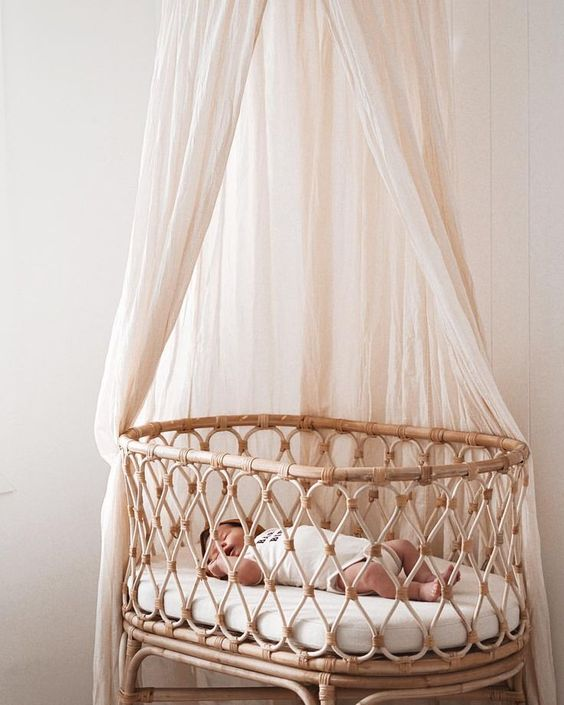 accent the bassinet with a neutral mosquito net and keep the bugs away from your little baby