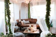 bring a boho feel to your living room with a mosquito net with lights and greenery all over