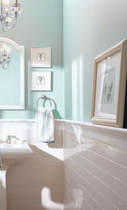 use sleek ledges in your bathroom to display art and accessories and make the space look cooler