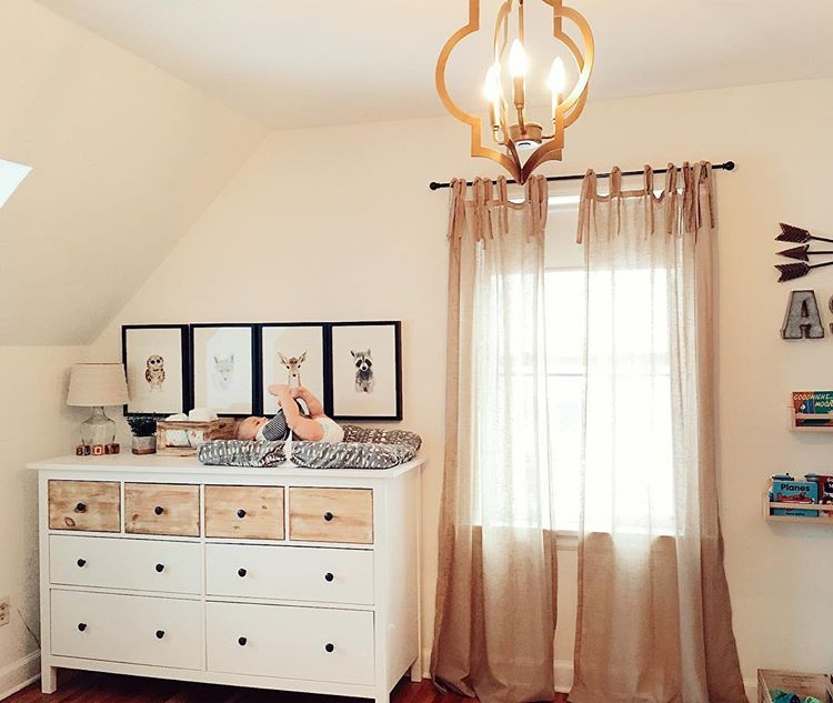 Hang some cute pictures above the dresser to create a cozy corner to change your baby. (via @birch_and_olive)