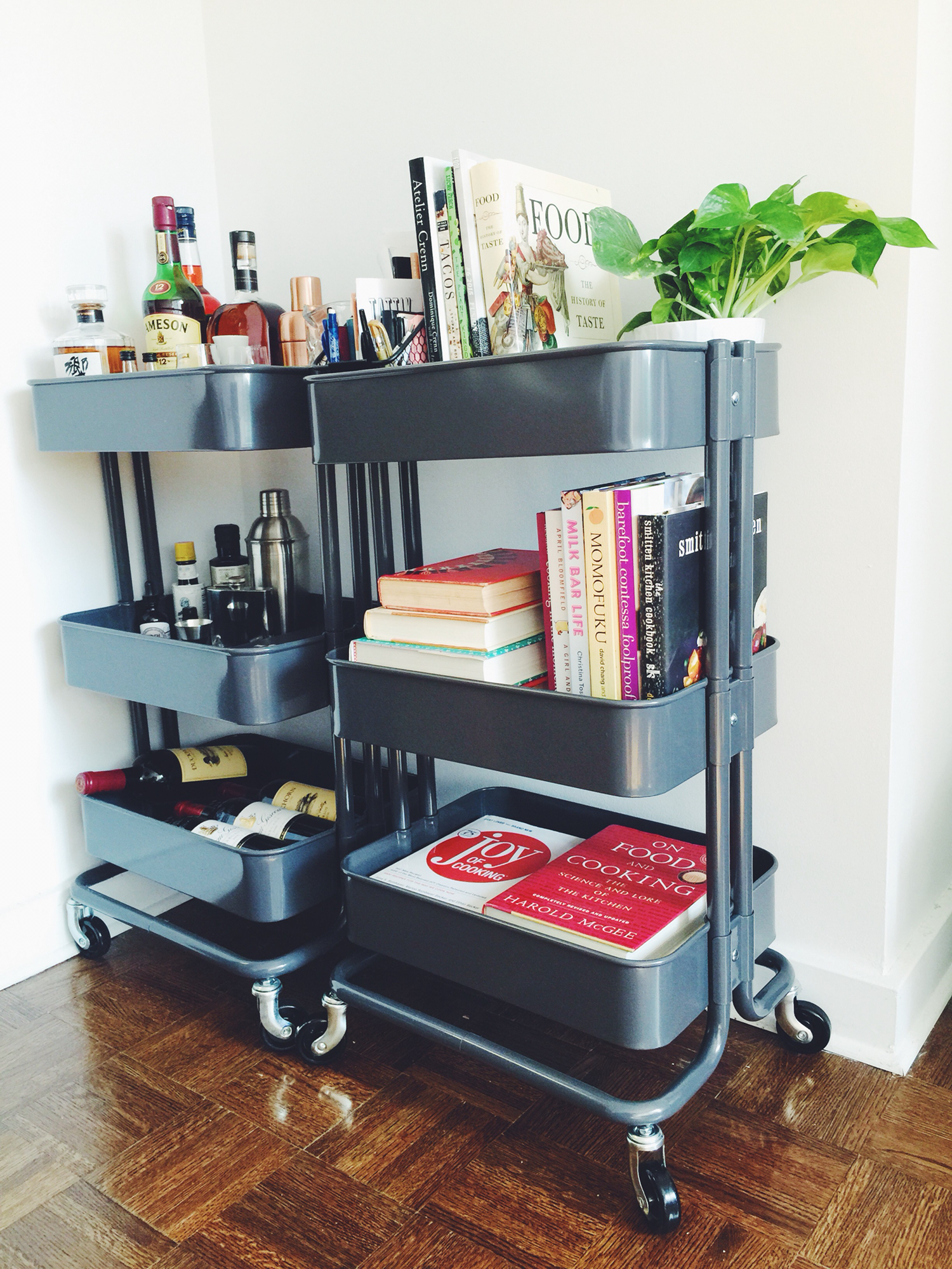 Two black carts here are used as a mixing station and as a storage rack for cooking books.