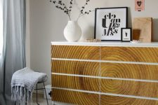 IKEA Malm dresser hack with gorgeous wood-imitating stickers that add texture and structure to the space