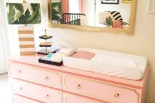IKEA Malm dresser with coral paint, trim and ring pulls as a stylish mid-century modern changing table