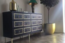IKEA Malm hack in navy, with yellow drawer trim, ring pulls and brass legs for a touch of vintage elegance