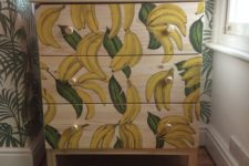 IKEA Tarva hack with painted bananas andgold knobs is a playful and whimsy item for storage