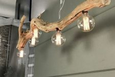 a beautiful and cool driftwood pendant lamp with large bulbs looks stylish, chic and very cool and inspires to reuse and recycle
