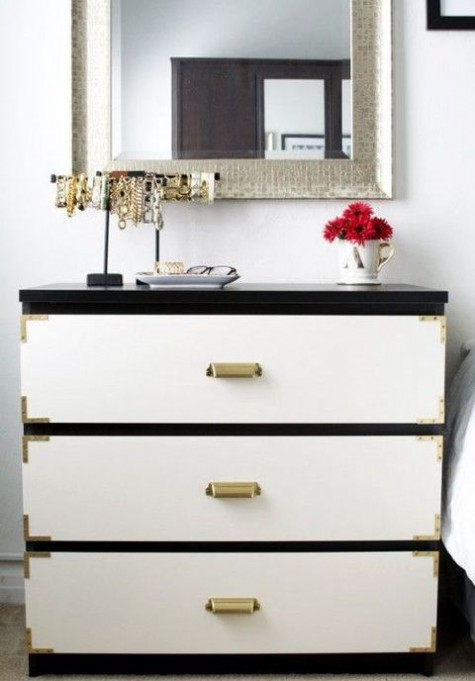a black IKEA Malm dresser with white drawers, metallic corners and vintage metal handles for a touch of classic glam