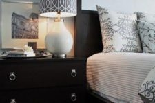a black Malm dresser with pretty ring pulls is a chic nightstand for a bedroom