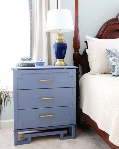 a blue Tarva hack with painted inlays, brass handles and catchy legs for a coastal bedroom