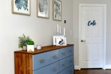 a bold Tarva hack with rich-colored stain and blue paint, with brass handles for a mid-century modern space