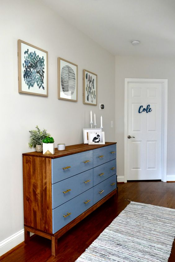 a bold Tarva hack with rich colored stain and blue paint, with brass handles for a mid century modern space