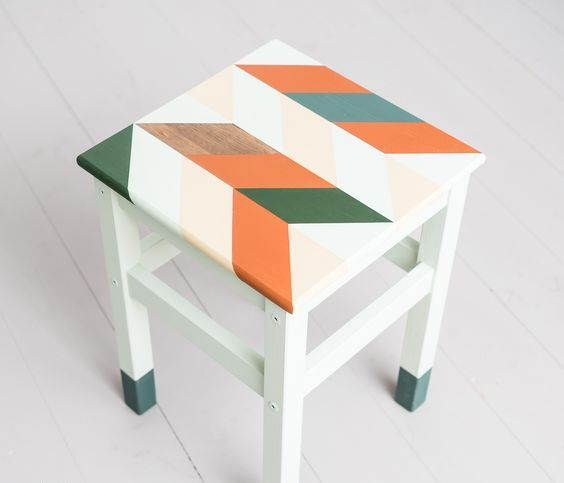 a bright IKEA Oddvar hack with dipped legs and a bright stenciled seat for a mid-century modern touch
