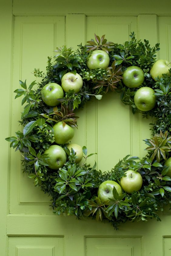 a bright green fall wreath of greenery and green apples is a chic and cool idea to rock in the fall