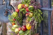 a cool fall wreath design with greenery