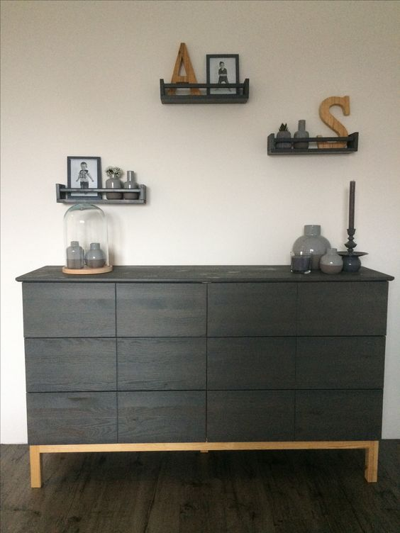 a contemporary IKEA Tarva hack with dark stain, no knobs or handles and a light colored frame and legs
