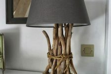 a cool and simple table lamp with a base covered with driftwood and a black lampshade is a lovely idea for a modern interior