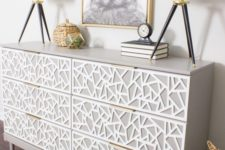 a creative Tarva dresser hack in dove grey, with white geometric inlays and tiny brass pulls